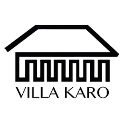 Villa Karon logo. Piirros päärakennuksesta. Alla lukee 'Villa Karo'.